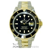 Rolex Submariner Date 18 kt. Yellow & S. Steel