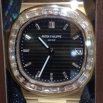 Patek Philippe Nautilus Rose Gold & Baguette Diamonds 5723