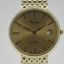 "Bouchard ""Classic"" 14K gold case and bracelet"