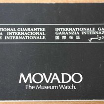 Movado vintage warranty watch or chronograph  papers and booklet