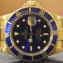 Rolex Submariner Date in 18k Yellow Gold Box and Papers