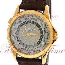 Patek Philippe World Time, Guilloched Silvery Sunburst...