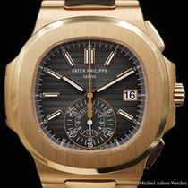 Patek Philippe Ref# 5980/1R-001, black dial, Nautilus,...