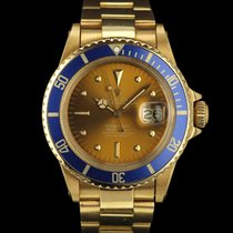 Rolex SUBMARINER 18K YELLOW TROPICAL DIAL