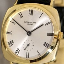 Patek Philippe Automatic cushion-shaped 18K gold vintage...