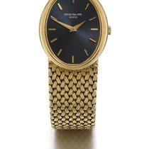 Patek Philippe | A Lady's Yellow Gold Oval Bracelet Watch...