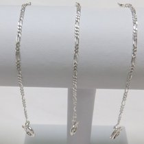 Lot of three silver chains, Cartier style, for key watch Two...