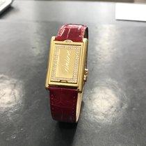 Cartier Tank basculante or jaune 18k et diamants