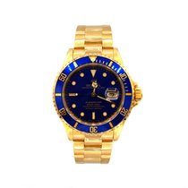 Rolex YELLOW GOLD SUBMARINER