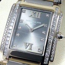Patek Philippe TWENTY 4 DIAMONDS - 4910/20G-010 - (Women) -...
