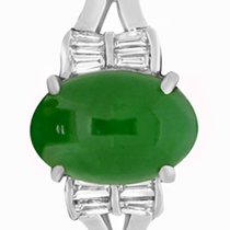 Oval jade stone 11x7mm set in 18k white gold mounting. Size 6....