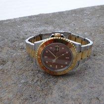 Rolex GMT Master II Tiger Eyes mit B&P von 2006