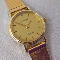 Tissot 14ct solid golden model with two strap