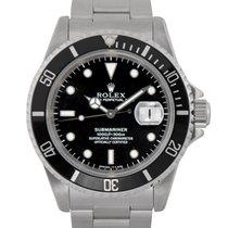 Rolex Steel Submariner Ref: 16610. Papers & Under Rolex...