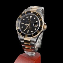 Rolex submariner steel and gold black dial