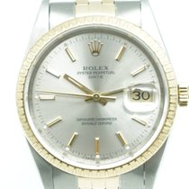 Rolex Oyster Perpetual Date 34mm Silver Gold Stick Dial