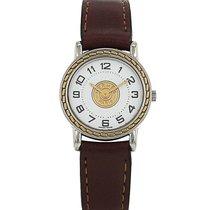 Hermès Sellier - wristwatch en plaqué or et acier