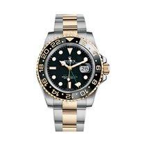 ロレックス (Rolex) GMT-Master II Black steel and 18k Yellow Gold...