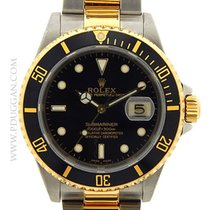 Ρολεξ (Rolex) stainless steel and 18k yellow gold Submariner