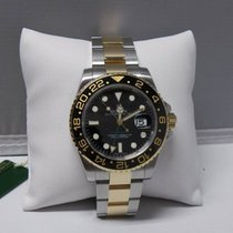 Rolex GMT master ll 116713 Black Dial Steel and 18k Yellow Gold