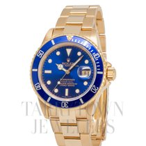 Rolex Yellow gold Automatic Blue 40mm pre-owned Submariner Date