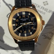 Patek Philippe Yellow gold Automatic Black Arabic numerals pre-owned Aquanaut