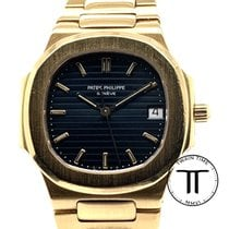 Patek Philippe Yellow gold Quartz Black No numerals 33mm pre-owned Nautilus