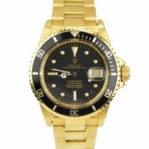 Rolex Yellow gold Automatic Black 40mm pre-owned Submariner Date