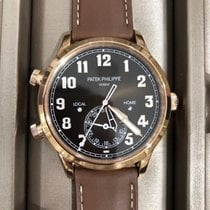 Patek Philippe Travel Time Rose gold 42mm Brown Arabic numerals