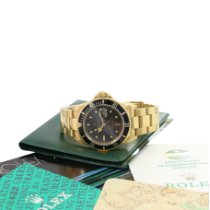 Rolex 16808 Yellow gold Submariner Date 40mm pre-owned United States of America, California, Los Angeles