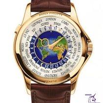 Patek Philippe World Time Oro amarillo 39.5mm Blanco Arábigos