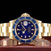 Rolex Submariner Date gebraucht 40mm Blau Datum Gelbgold
