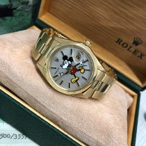 Rolex Oyster Perpetual Date Zuto zlato 34mm Boja šampanjca Bez brojeva