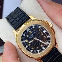 Patek Philippe Aquanaut Or jaune Noir Arabes France, Bastia