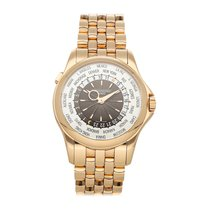 Patek Philippe World Time pre-owned 39.5mm Silver GMT Rose gold