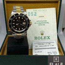 Rolex Submariner Date 16803 Muy bueno Acero y oro 40mm Automático