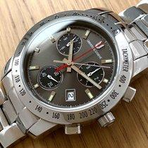 Universal Genève Compax new 1990 Quartz Chronograph Watch with original box and original papers 875.214