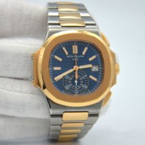 Patek Philippe Nautilus Gold/Steel 40.5mm Blue No numerals United States of America, New York, New York