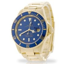 Rolex Yellow gold Automatic Blue No numerals 40mm pre-owned Submariner Date
