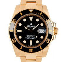 Rolex Yellow gold Automatic Black No numerals 40mm pre-owned Submariner Date