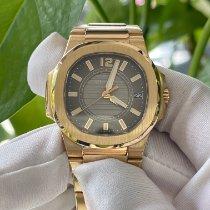 Patek Philippe Pозовое золото Кварцевые Cерый Aрабские подержанные Nautilus
