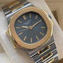 Patek Philippe Nautilus pre-owned 37mm Blue Date Gold/Steel