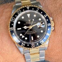 Rolex GMT-Master II Gold/Steel 40mm Black No numerals Finland, HELSINKI