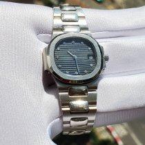 Patek Philippe Platinum Quartz Blue No numerals 27mm pre-owned Nautilus