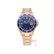 Rolex Submariner Date tweedehands 40mm Blauw Datum Geelgoud