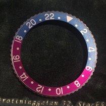 Rolex GMT bezel and fuchsia insert