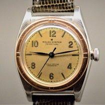 Rolex Bubble Back Gold/Steel 32mm Champagne Arabic numerals