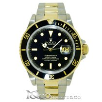 Rolex Submariner Date 18 kt. Yellow & S. Steel