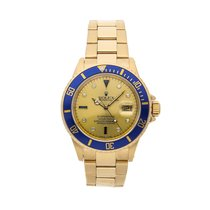 Rolex Yellow gold Automatic Champagne No numerals 40mm pre-owned Submariner Date