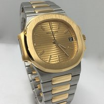 Patek Philippe Nautilus Steel and Yellow Gold Champagne Dial...